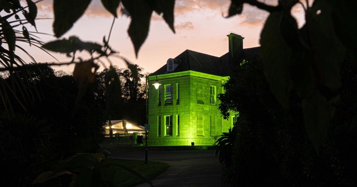 Tremough House illuminated green