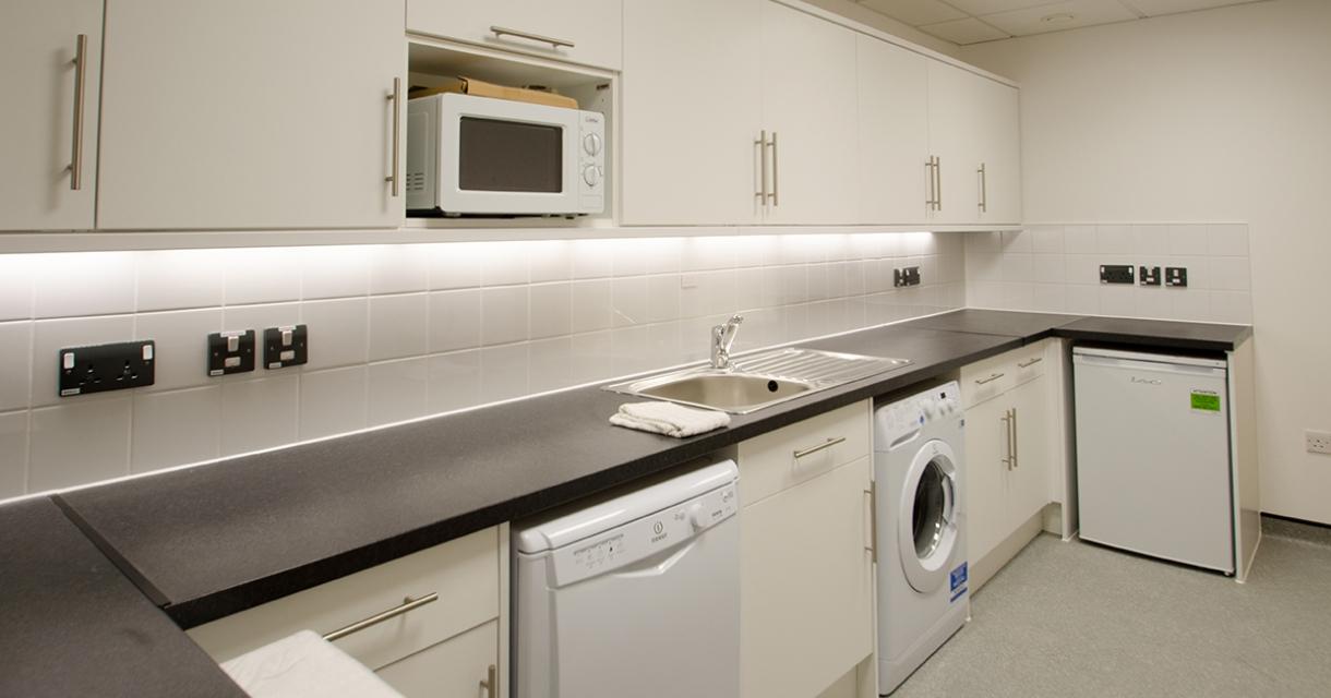 White kitchen with appliances.