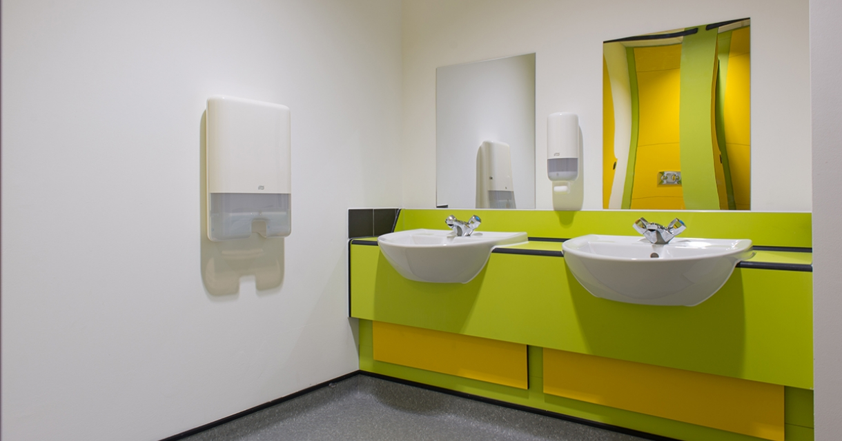 Two sinks set in a lime green and yellow unit.