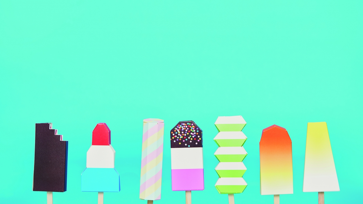 Lineup of ice lollies on bright blue backdrop. Commercial Photography Work by Harry Lawlor