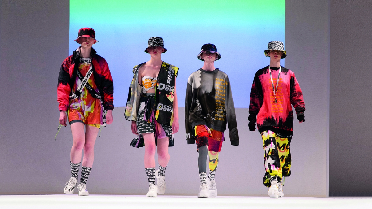 Models wearing student designs on the catwalk