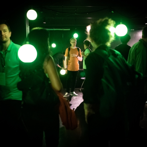 A group of people in green light