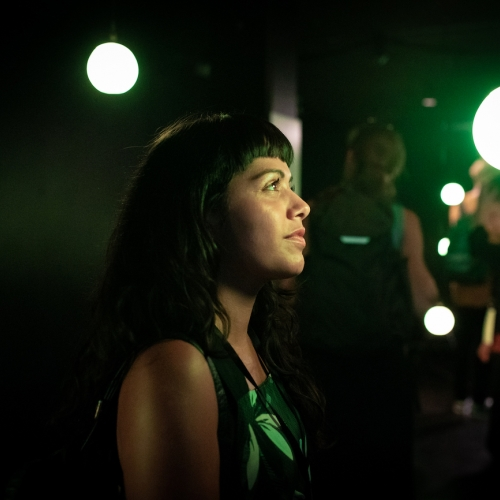 A girl with black hair in green light