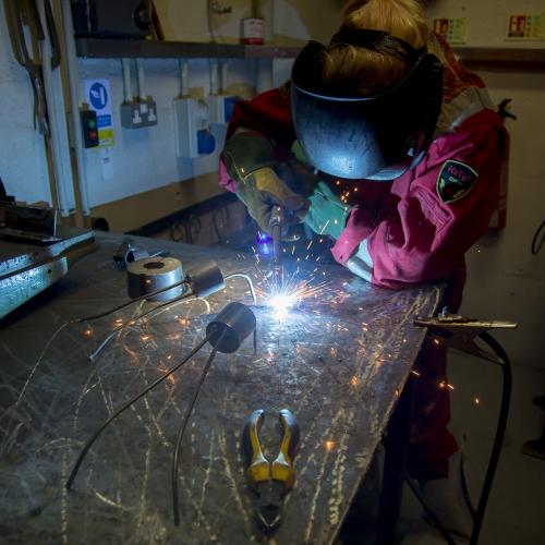 Student working in metal work studio