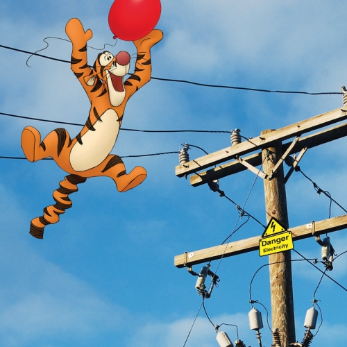 Tigger floating towards telegraph wires