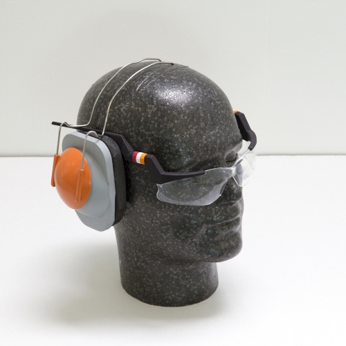Mannequin head with glasses and headphones.