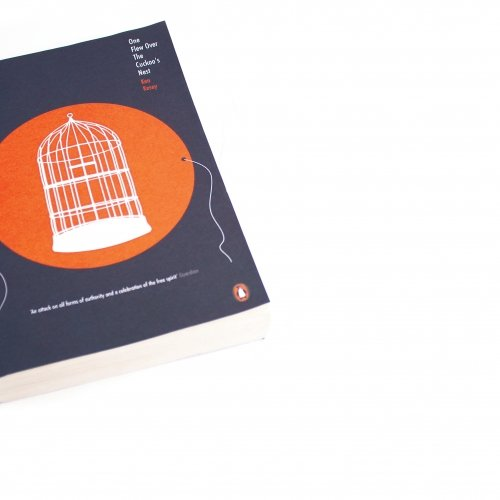 Book cover with empty birdcage for One Flew Over the Cuckoo's Next.