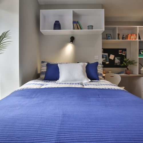 Double bed with navy blue cover