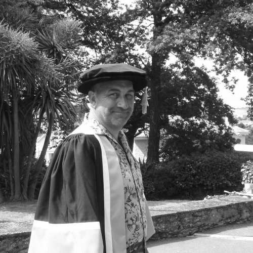 Falmouth honorary fellow Bill Mitchell in academic gown.