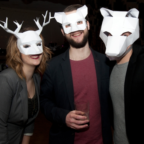 Audience members at House of Animals wearing white paper animal masks