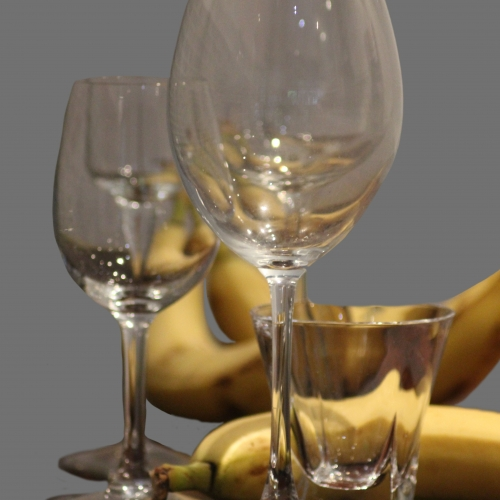 Wine glasses and bananas still life
