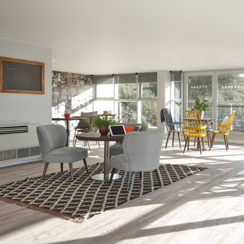 Living interior with dining table and arm chairs