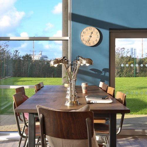 Dining room with large table looking out to a garden