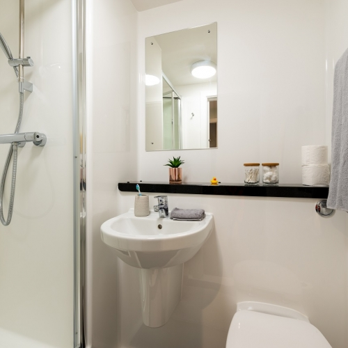 Bathroom interior with shower and sink