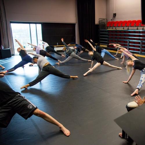 Dancers in studio stretching.