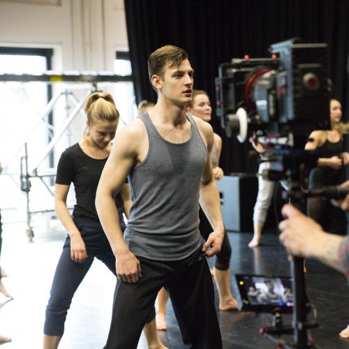 Male dancer being filmed.