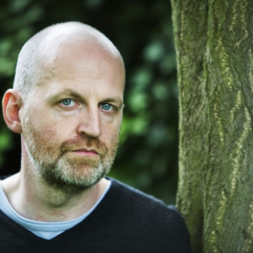 Portrait of Don Paterson OBE, English & Writing guest speaker stood next to tree.