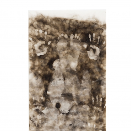 Hand and feet imprints on brown paper