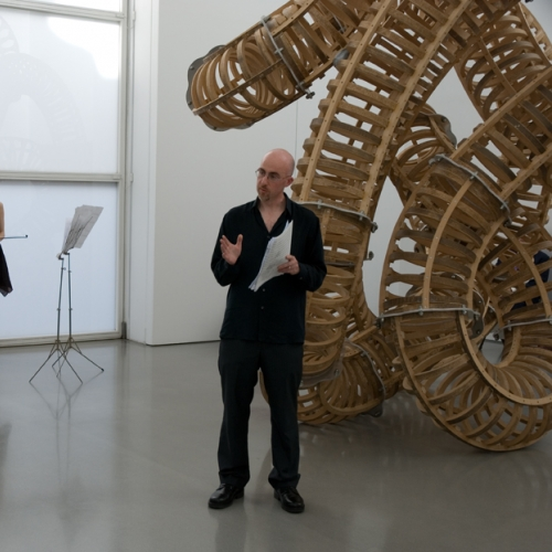 Man dressed in black in an art gallery