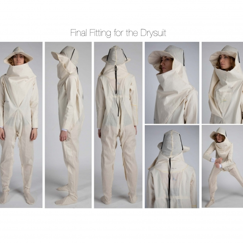 White papery looking boiler suit that goes over head and into a peaked hat.