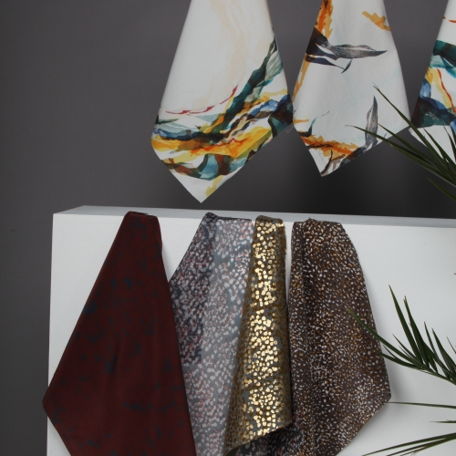 A display of digitally printed and foiled designs.