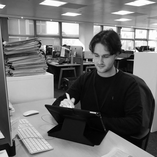 Illustration graduate Jake Hawkins at his desk
