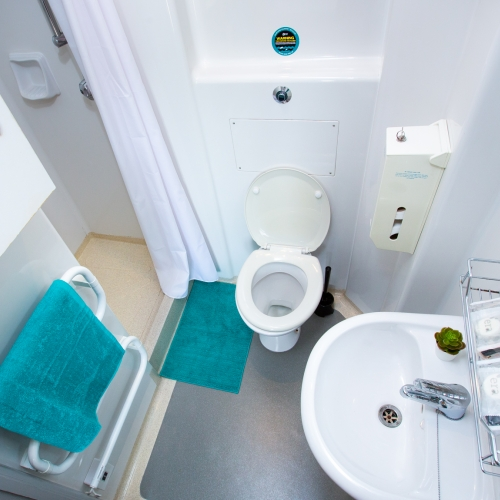 Ensuite bathroom with walk-in shower, heated towel rail, toilet and sink at Glasney Student Village