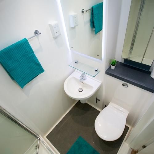 Packsaddle Hill bathroom with shower, toilet and sink