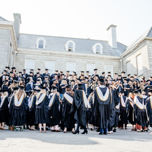 Falmouth University graduates gathering for a group photograph at Graduation 2019
