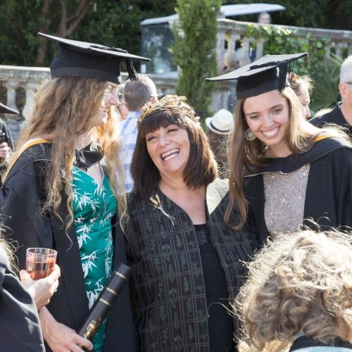 Chancellor Dawn French laughing with Falmouth University graduates at Graduation 2019.