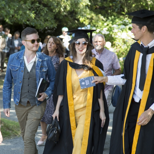 Falmouth University graduates and guests enjoying the gardens at graduation 2019