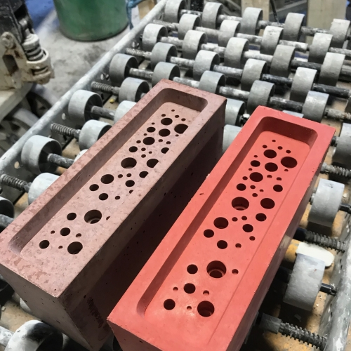 Red and pink brick with holes in the face