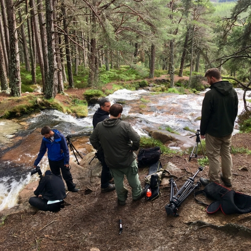 Film crew by waterfall