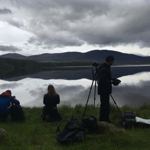 Students at the edge of a lake