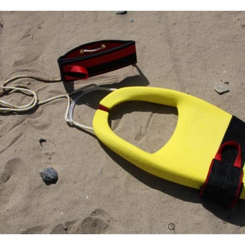 Yellow life float design on beach.