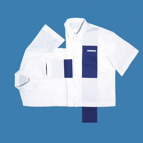 Flat lay of white shirt with blue rectangle patch on blue background.