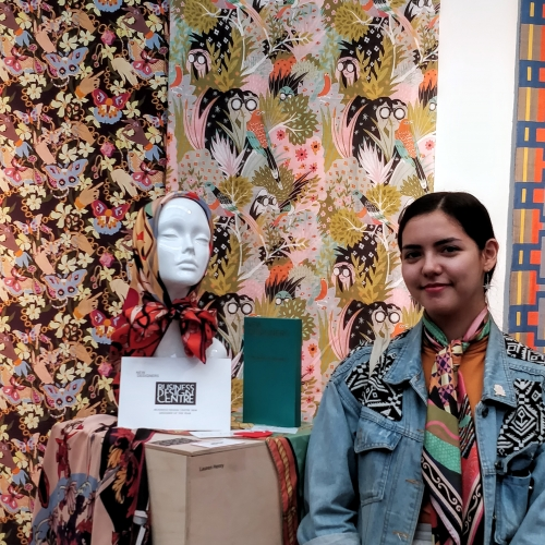 student Lauren Henry with textile designs