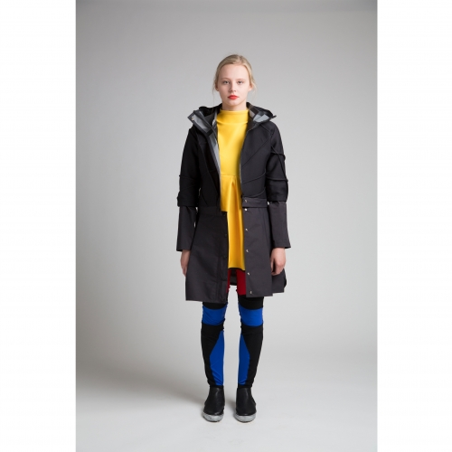 Model in yellow dress and black jacket.