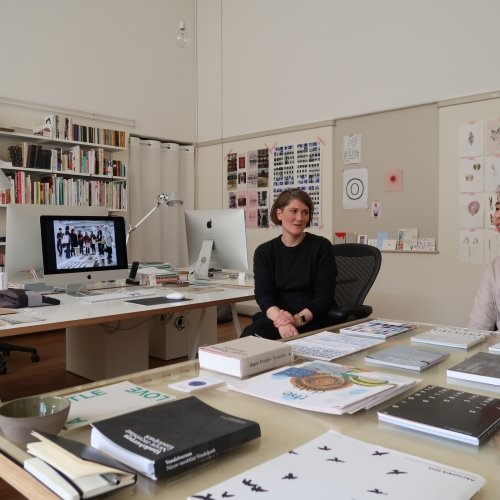 Two females in design studio in Amsterdam surrounded by design work and books