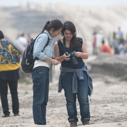 Students checking through shots on camera .