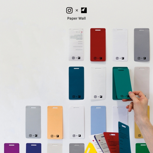 Wall of phone shaped coloured pieces of paper.