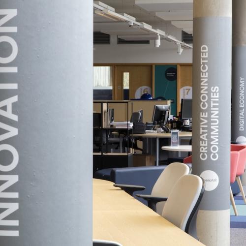 Building interior with innovation written on a grey pillar