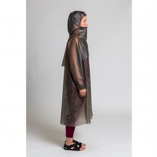 Model in transparent black raincoat.