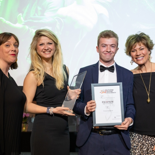 Cameron Smith receiving his award for PEGA Student Photographer of the Year