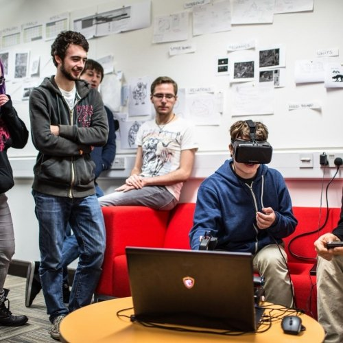 Student wearing a virtual reality headset with group of students