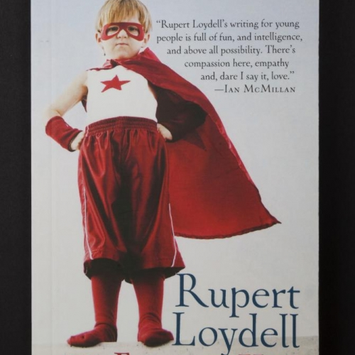 Book cover featuring little boy in red mask and cape hero outfit for The Fantasy Kid by senior lecturer, Rupert Loydell.