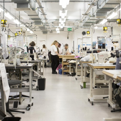 A view of the fashion department facilities tables with sewing machines, overlockers and lot's of technical equipment.