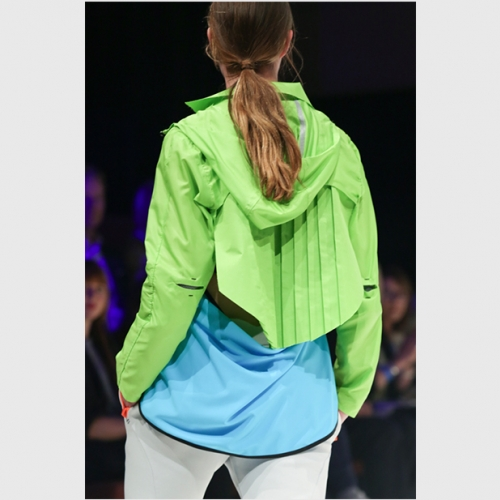 Model in lime green hooded jacket.