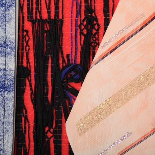 Fabric samples in various textures and colours.