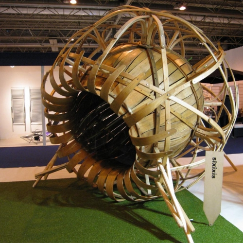 Large flower shaped sculpture made of curved wood.